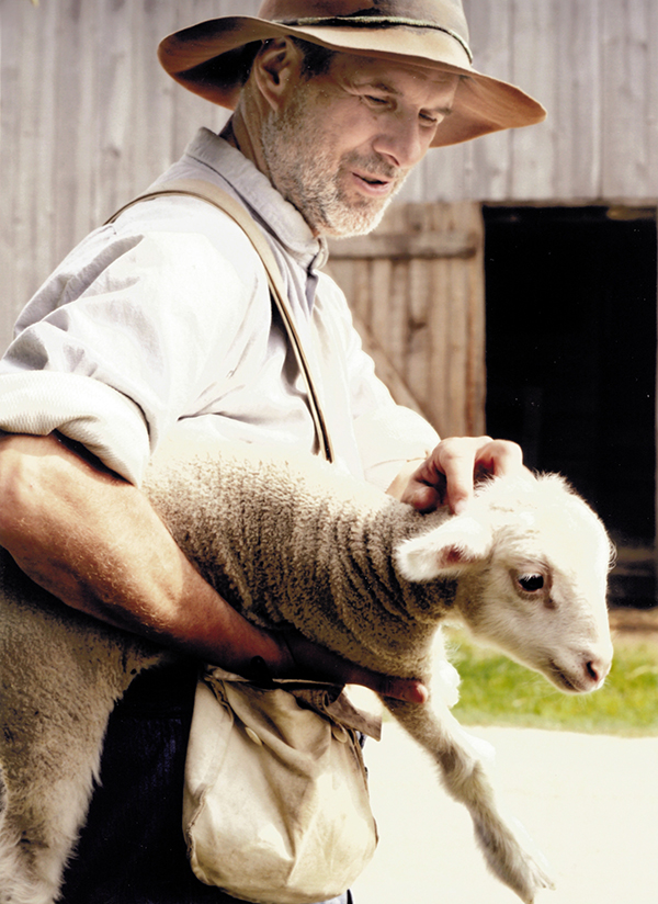 Farmer with lamb at Old World Wisconsin.